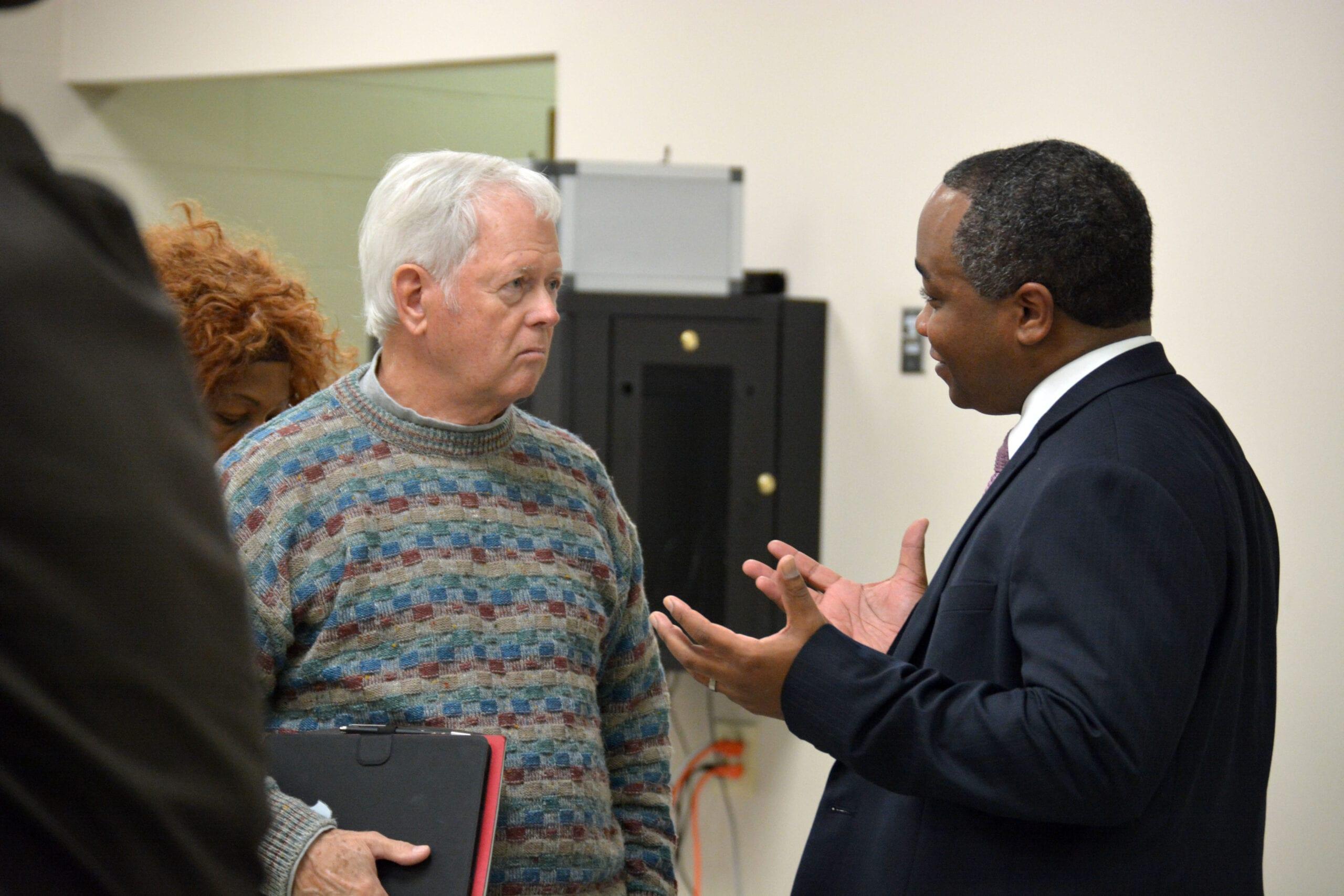 DA Merriweather speaking with a citizen